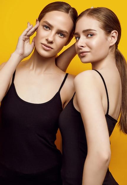 Two beautiful sensual young women posing Premium Photo