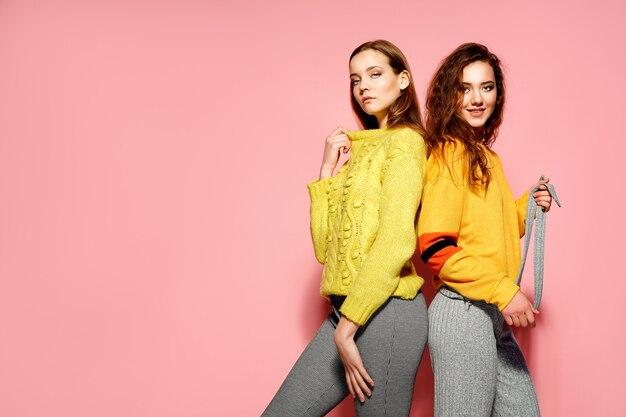 Two beautiful smiling gorgeous friends posing Premium Photo
