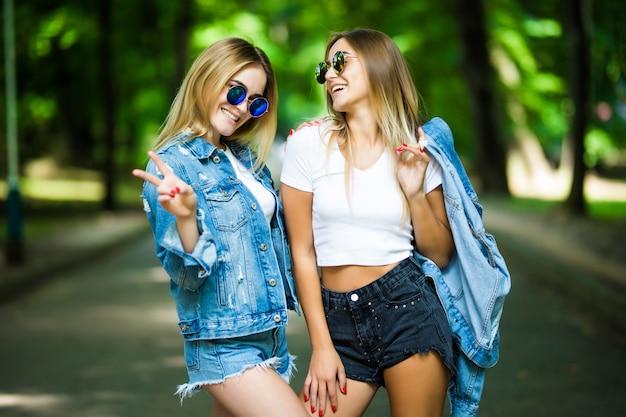 Two beautiful young women having fun in the city Free Photo