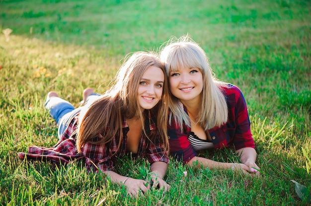 Two beautiful young women having fun outdoors Premium Photo