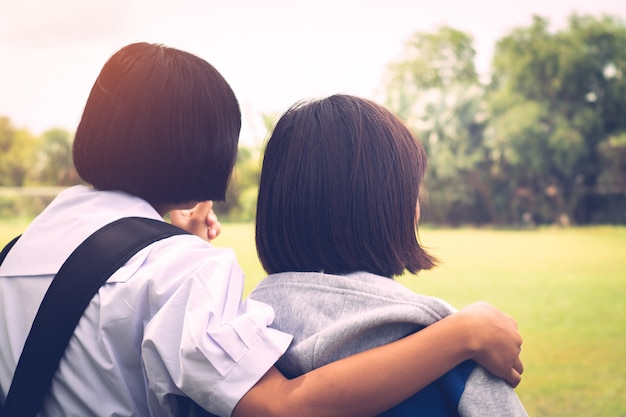 Two best girl friends  thinking and hugging with love Premium Photo