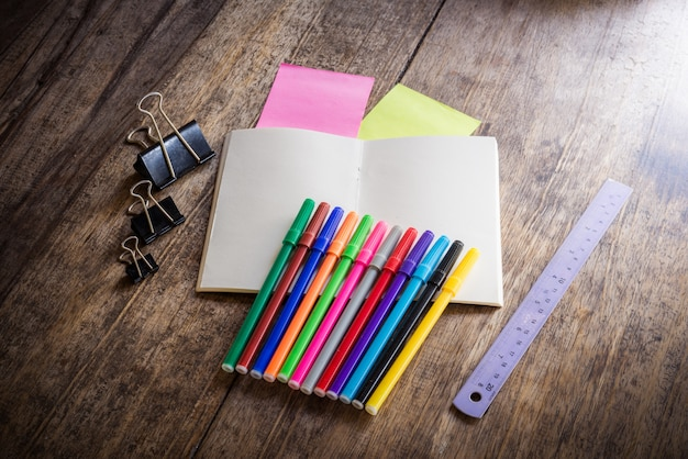 Two blank colorful sticky notes , notebook ,pencil ,highlighter, clip, magic colors, ruler Premium Photo