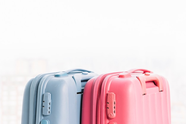 Two blue and pink baggage suitcases Free Photo