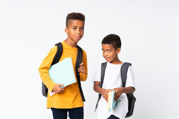 Two boys african american students over isolated white background Premium Photo