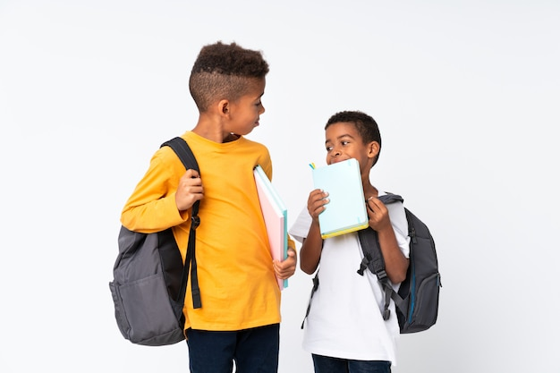Two boys african american students over isolated white Premium Photo