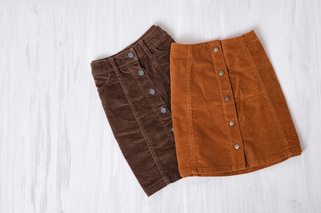 Two  brown skirts on a wooden surface Premium Photo