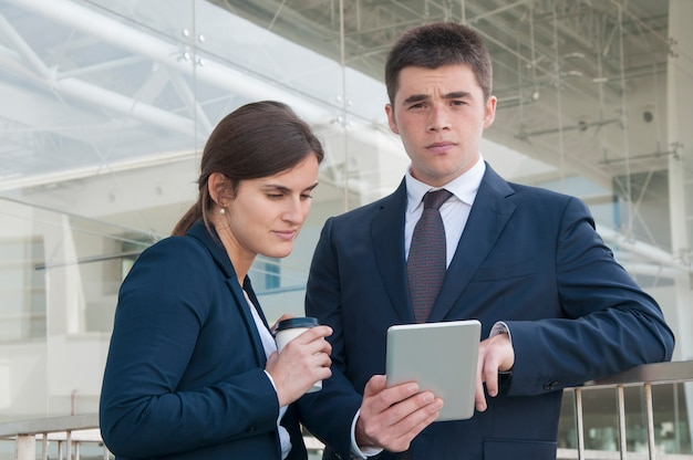 Two business colleagues studying reports Free Photo
