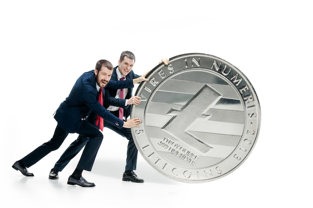 Two business men holding business icon Free Photo