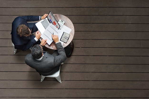 Two businessmen cafe meeting insurance application concept Premium Photo