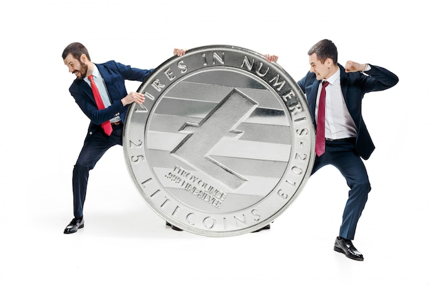 Two businessmen holding bitcoin Free Photo