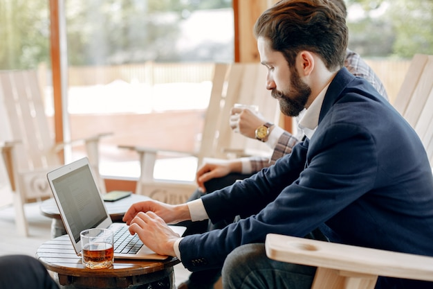 Two businessmen working at the office Free Photo