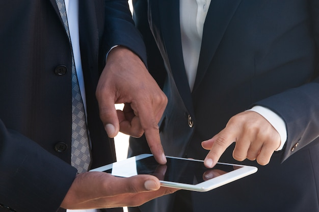 Two businesspeople using tablet together Free Photo
