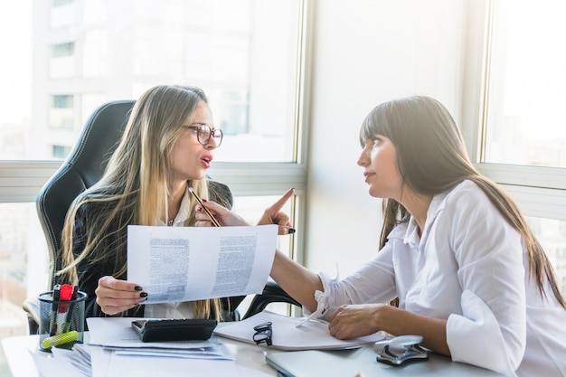 Two businesswoman arguing with each other in the office Free Photo