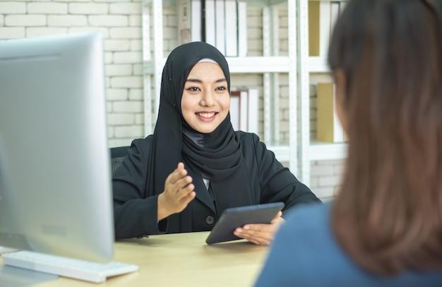 Two businesswoman muslim success meeting Premium Photo