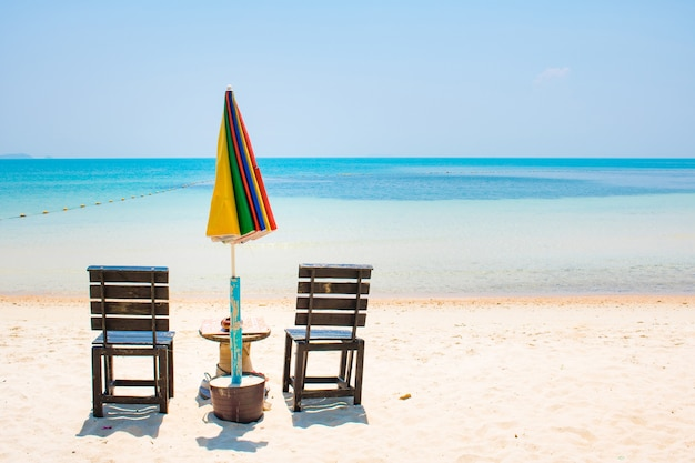 86a91a97d7 Two chairs with umbrela on white sand beach and blue sea in samed ...