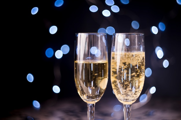 Two champagne glasses on bokeh background Free Photo