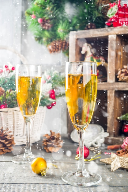 Two champagne glasses with christmas decoration Premium Photo