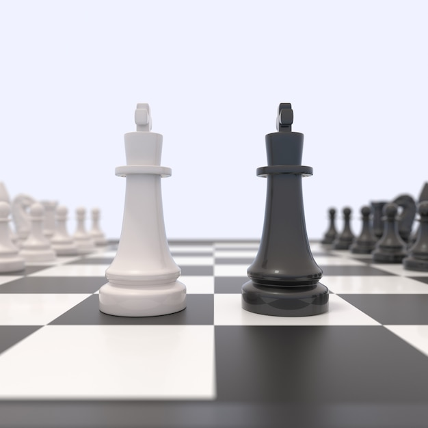 Two chess pieces on a chessboard. black and white kings facing each other. Premium Photo