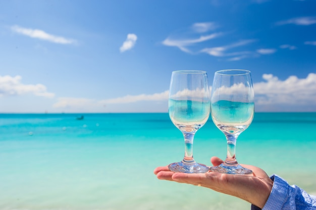 Two clean glasses on background of turquoise sea Premium Photo