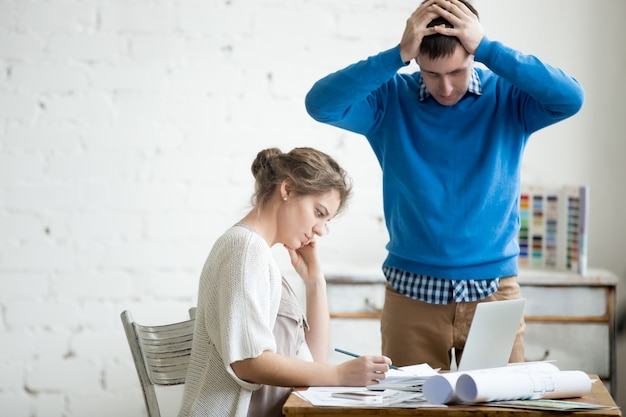 Two colleagues feeling troubled at work Free Photo