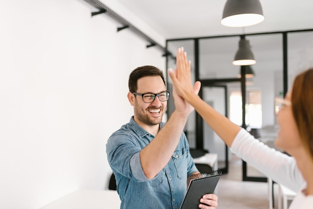Two colleagues high-five. Premium Photo