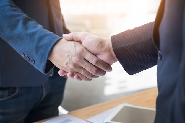 Two confident business man shaking hands during a meeting in the office, success, dealing, greeting and partner concept Free Photo