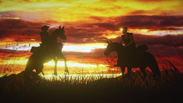 Два ковбоя на лошадях на фоне потрясающего заката на диком западе. Premium Фотографии