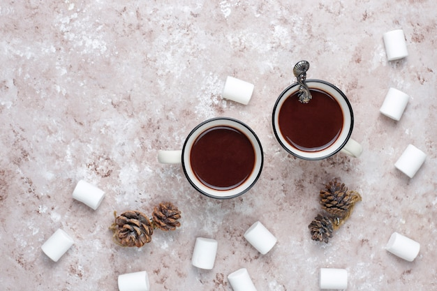 Two cup of hot chocolate with marshmallow on light Free Photo