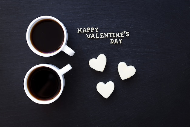 Two cups of coffee and candies in heart happy valentine Premium Photo