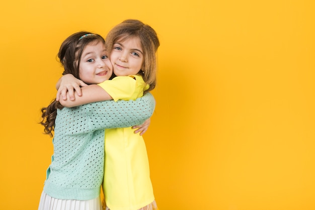 Two cute girls hugging Free Photo