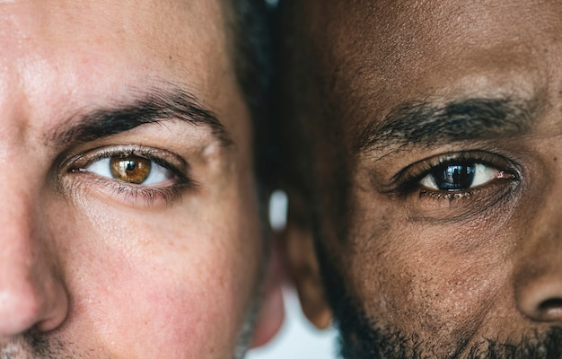 Two different ethnic men's eyes closeup Free Photo