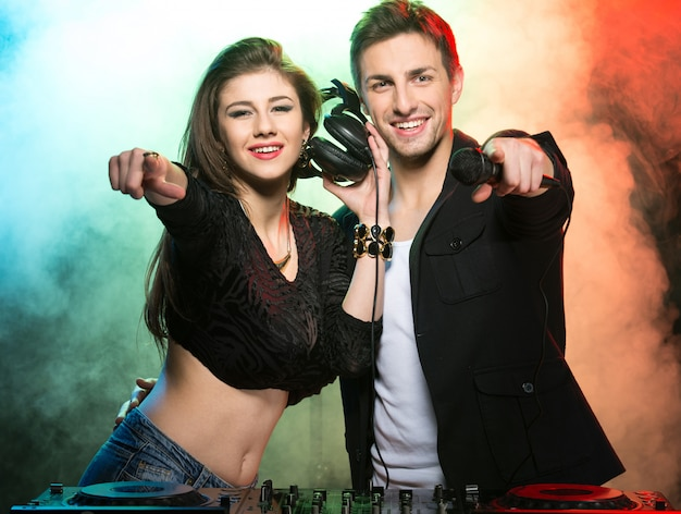 Two djs at the work in the club. Premium Photo