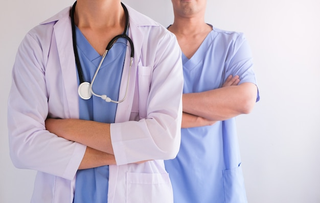 Two doctor team in the hospital for health care concept. blue uniform. Premium Photo