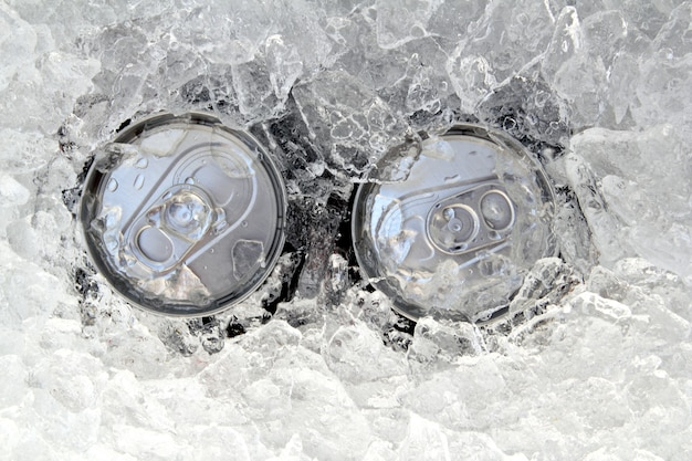 Two drink can iced submerged in frost ice Premium Photo