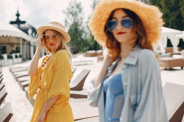 Two elegant girls on a resort Free Photo