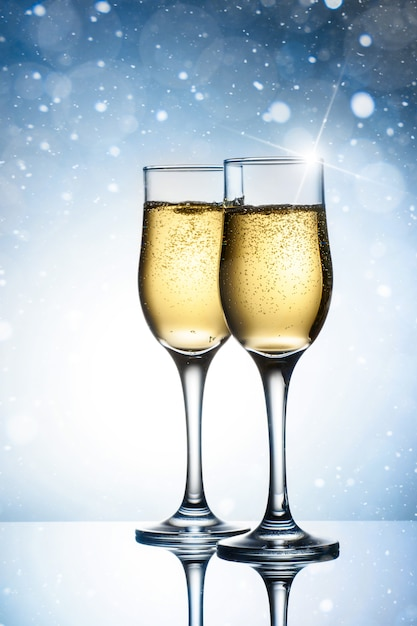 Two elegant glasses with sparkling champagne Premium Photo