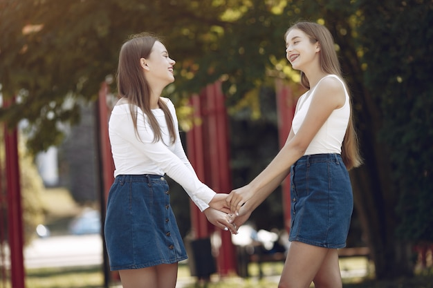 Two elegant and stylish girls in a spring park Free Photo