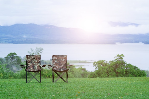 Two empty  folding chairs for outdoor camping Premium Photo
