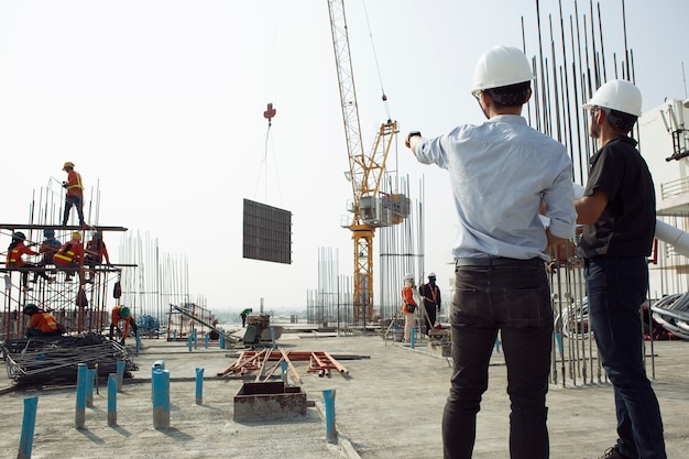 Two engineers work on the construction site Premium Photo