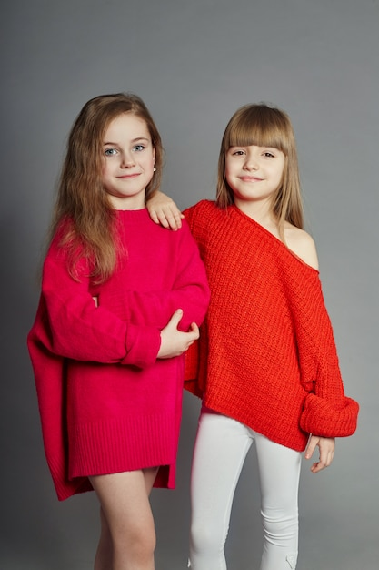 Two fashion girls kid in red jackets Premium Photo