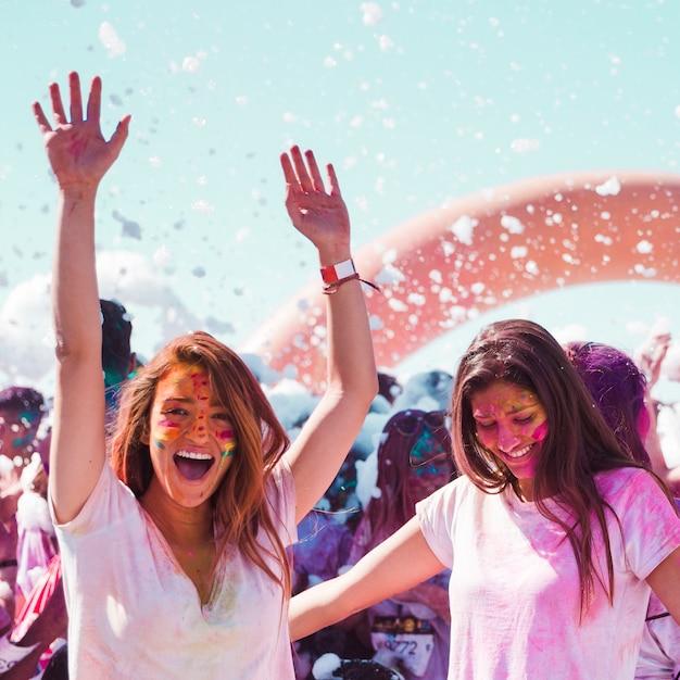 Two female friends enjoying the holi festival Free Photo