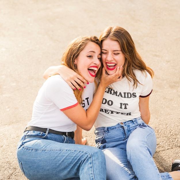 Two female friends making fun Free Photo