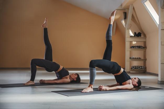 Premium Photo Two Fit Yogi Women In One Legged Wheel Yoga Pose Yoga Studio Interior Thanks a lot for posting all these helpful and inspiring poses. freepik