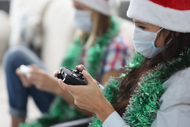 Two girlfriends play game console. Premium Photo