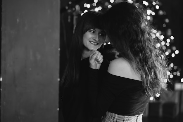 Two girls in each other's tender embraces Free Photo