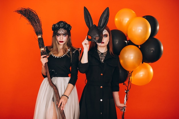 Two girls in halloween costumes Free Photo