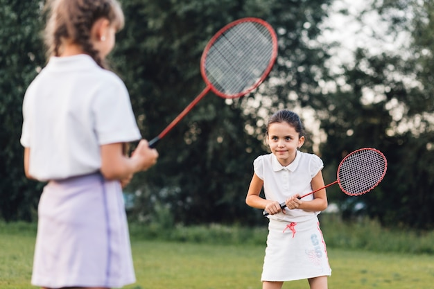 Two girls playing badminton in the park Free Photo