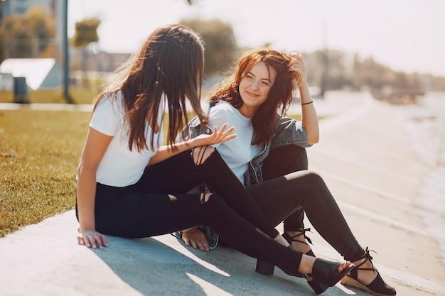 Two girls talking Free Photo