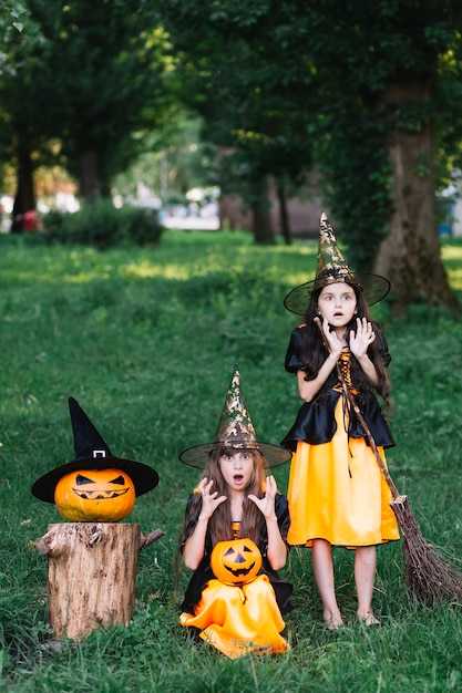 Two Girls In Witch Costumes Showing Fear Photo Free Download