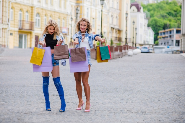 Two Girls With Shopping Bags Posing Photo